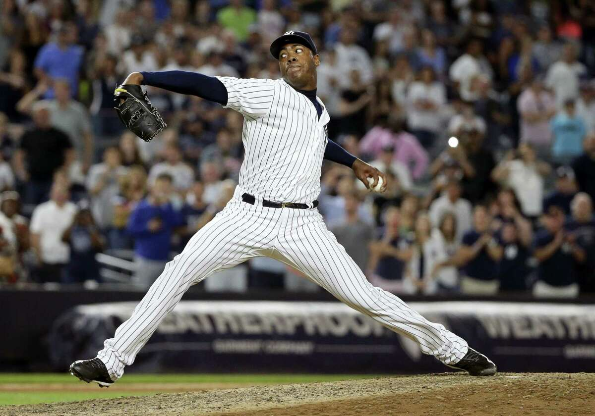 Aroldis Chapman delivers a pitch during the ninth inning of the Yankees' win over the Twins on Friday night in New York. The Yankees won 5-3.