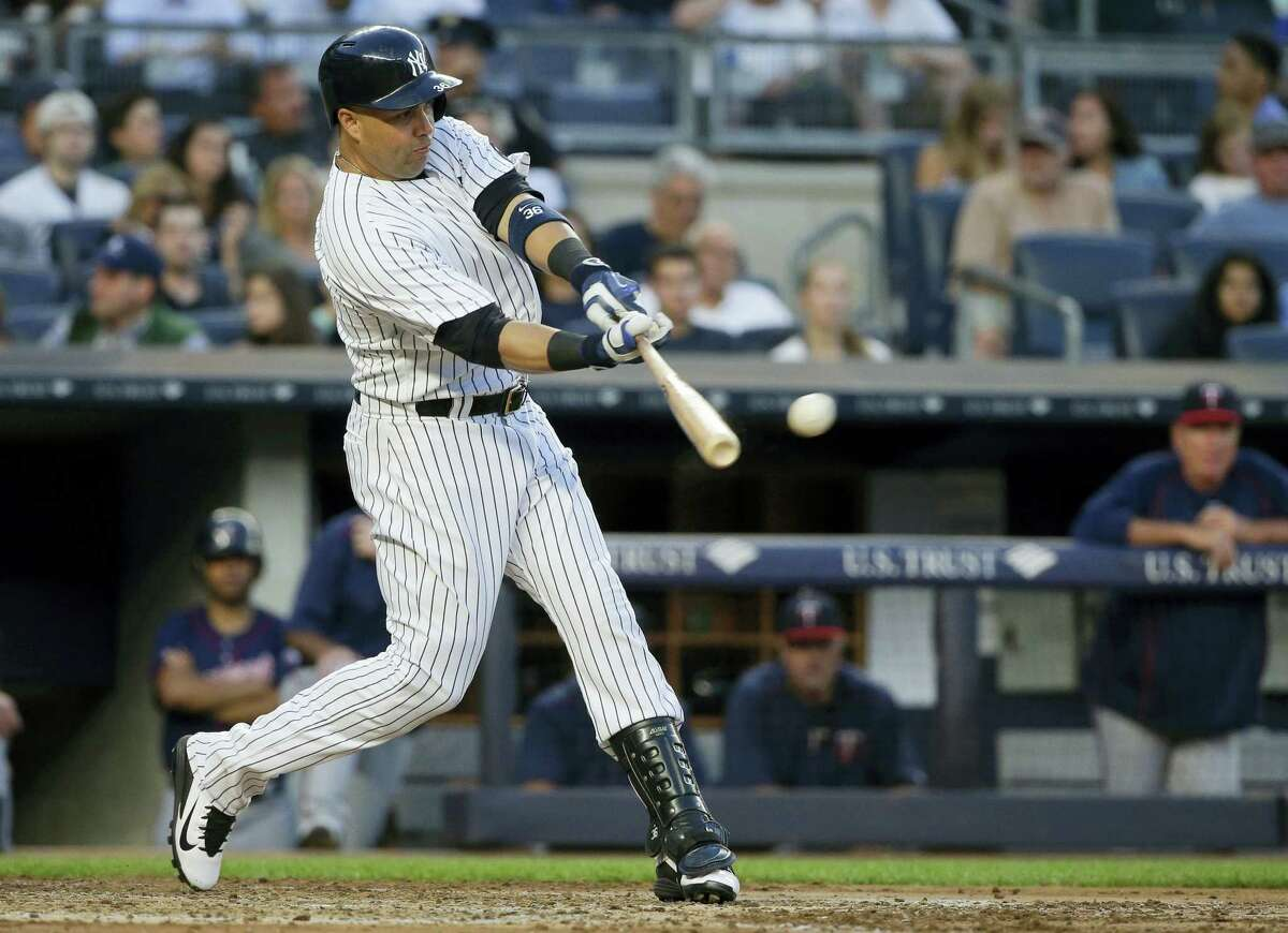 Carlos Beltran hits an RBI double during the third inning.