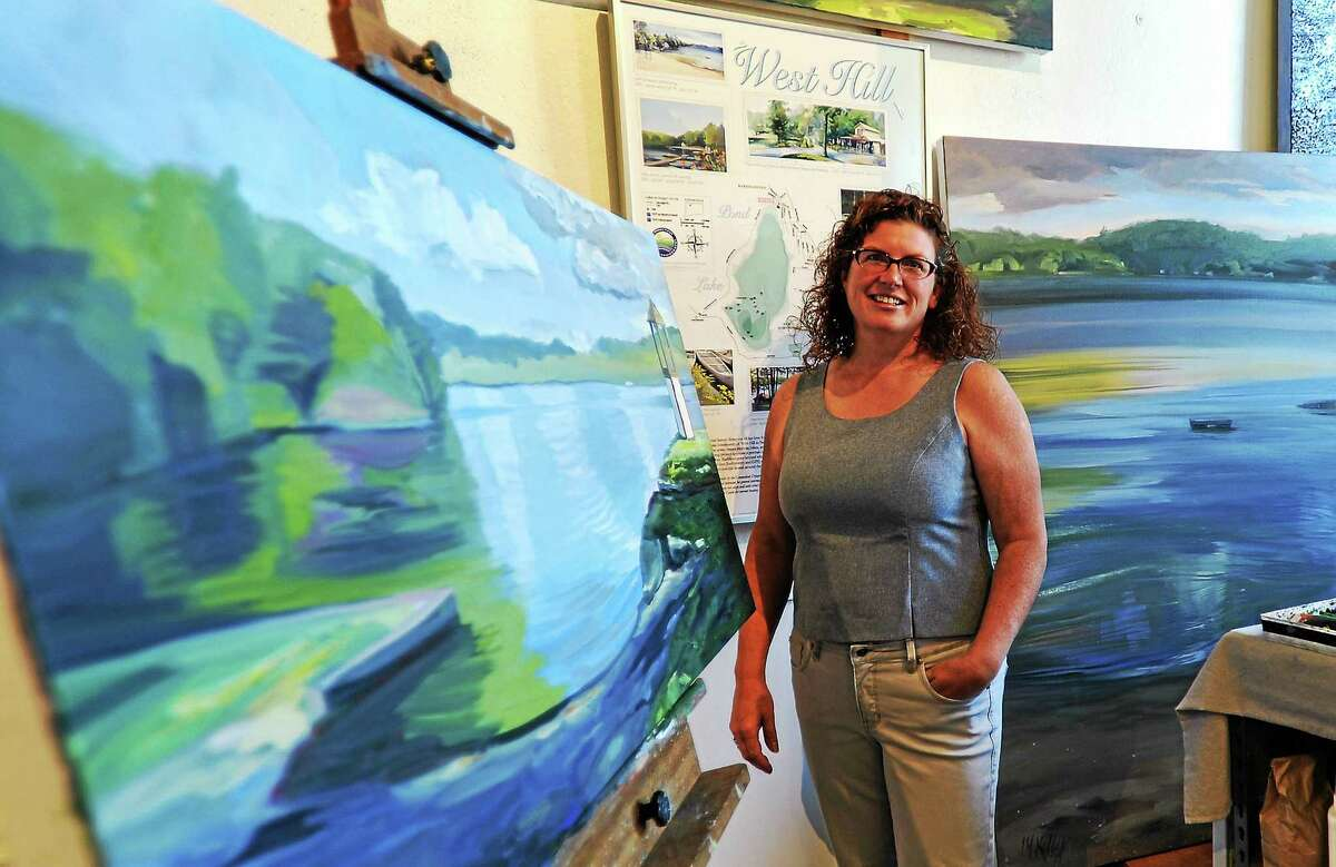 Kathleen Kelly in her studio with some of the West Hill Paintings. Behind her is an earlier version of the Special Edition print.