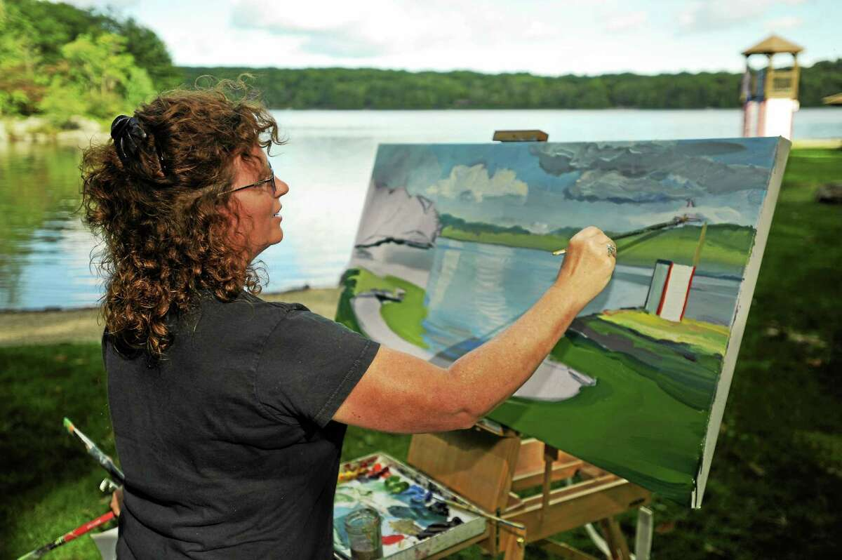 Kathleen Kelly paints at Camp Sequassen, a Boy Scout of America property on West Hill Pond with 540 acres of forest 2,500 feet of water frontage.