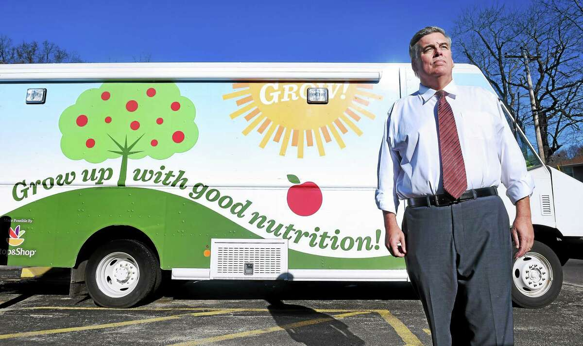 In this Jan. 13, 2015 file photo, Rob Levine, president and CEO of the Connecticut Food Bank, is photographed in front of the food bank in East Haven.