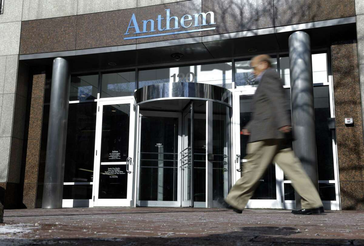 A man walks past health insurer Anthem's corporate headquarters in Indianapolis, Thursday, Feb. 5, 2015. Hackers broke into the company's database storing information for about 80 million people in an attack bound to stoke fears many Americans have about the privacy of their most sensitive information.