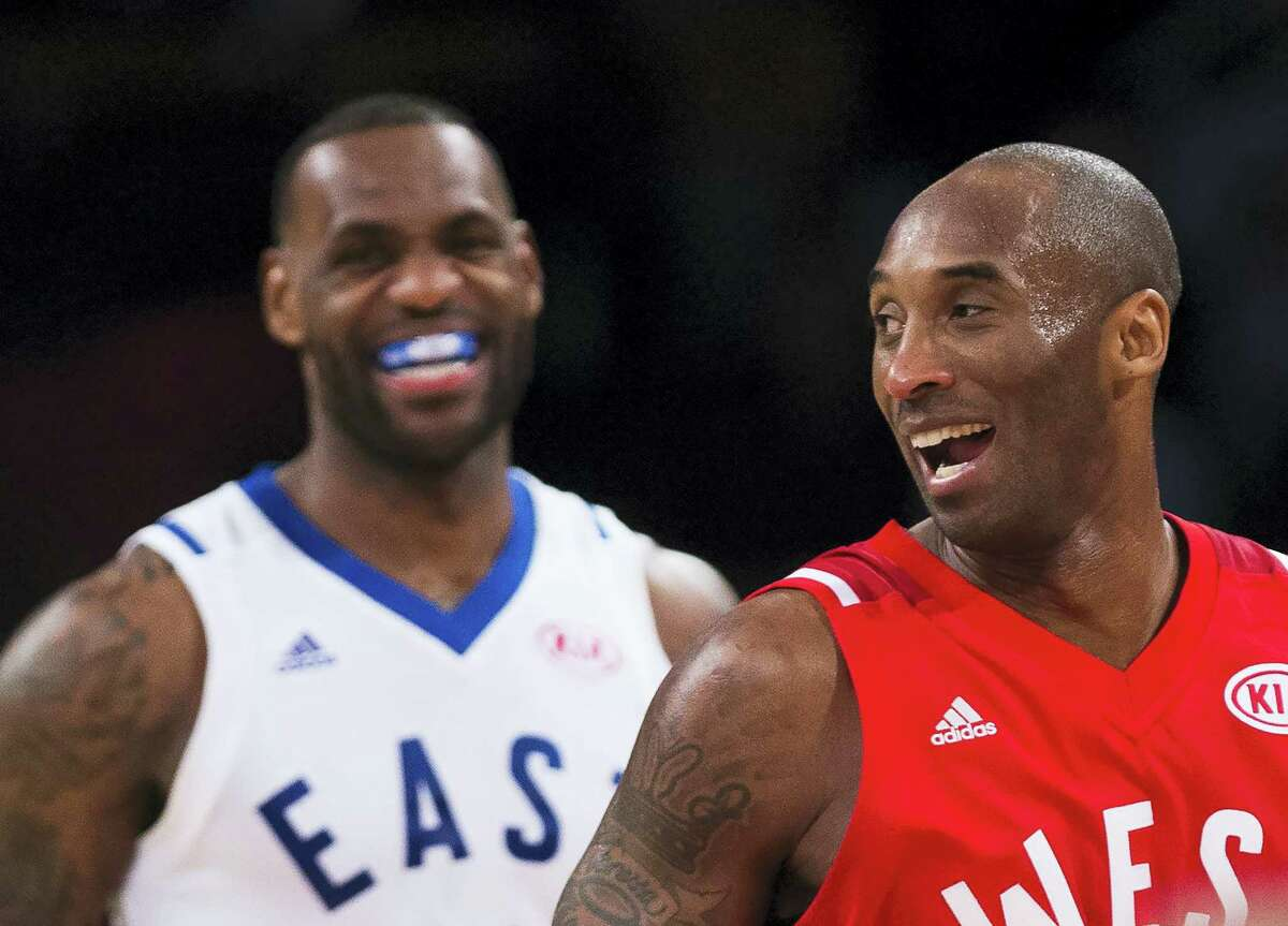 Western Conference's Kobe Bryant, of the Los Angeles Lakers, (24) and Eastern Conference's LeBron James, of the Cleveland Cavaliers, (23) laugh during second half NBA All-Star Game basketball action in Toronto on Sunday, Feb. 14, 2016. (Mark Blinch/The Canadian Press via AP) MANDATORY CREDIT