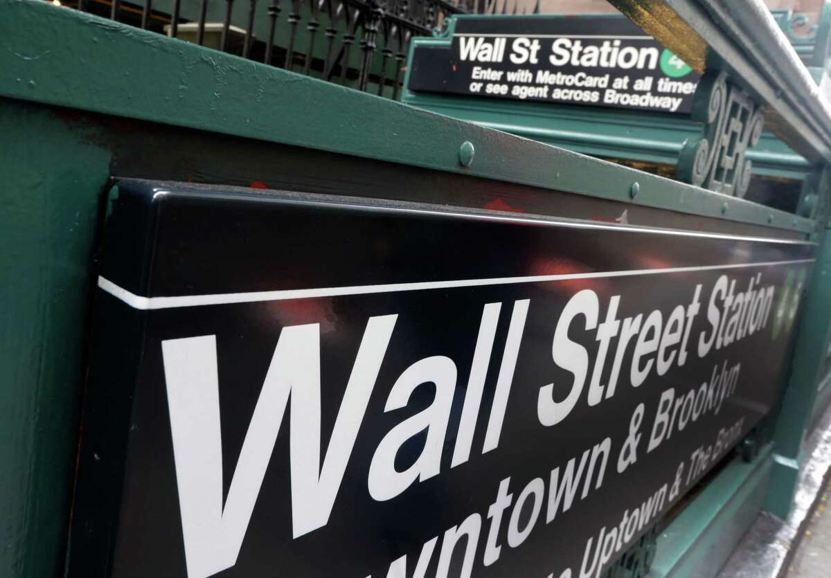 FILE - This Oct. 2, 2014 file photo shows the Wall Street subway stop on Broadway, in New York's Financial District. Asian stocks markets sagged Tuesday, June 16, 2015, as global jitters mounted over whether Greece and its creditors can reach a bailout agreement.