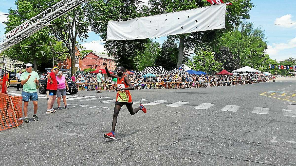 Moses Kiphosgei, 23, of Lansing, Michigan, came in second with a time of 34:20.