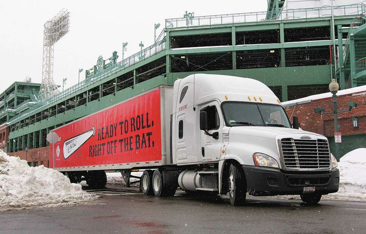 A truck full of Red Sox equipment leaves Boston Thursday en route to the team's spring training site in Fort Myers, Fla.