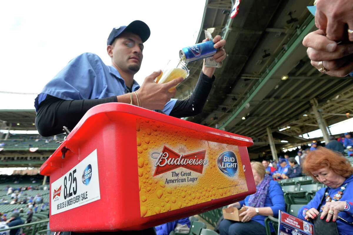 A beer vender pours Bud Light into a cup at Wrigley Field before Game 4 in baseball's National League Division Series between the Chicago Cubs and the St. Louis Cardinals Tuesday in Chicago.