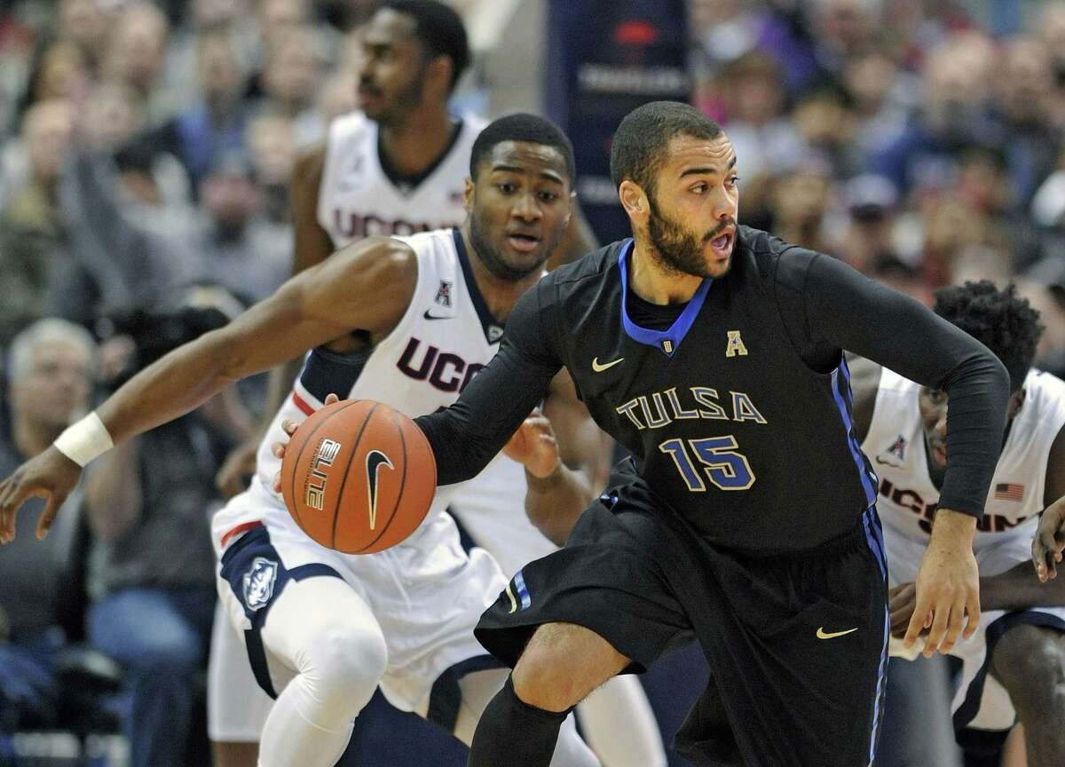 Tulsa's Marquel Curtis is guarded by UConn's Rodney Purvis (44) during the first half Thursday.