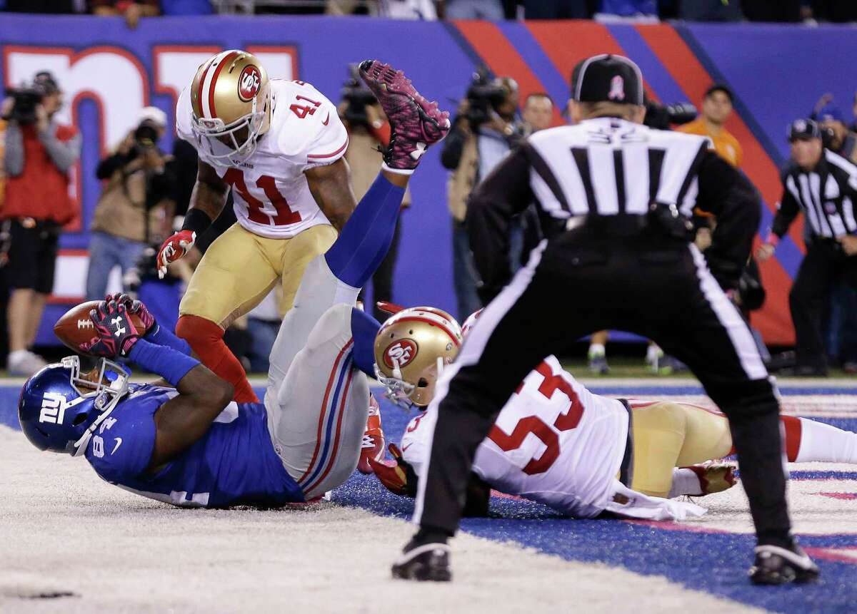 Giants tight end Larry Donnell (84) comes down with a catch for the game-winning touchdown against the 49ers on Sunday night.