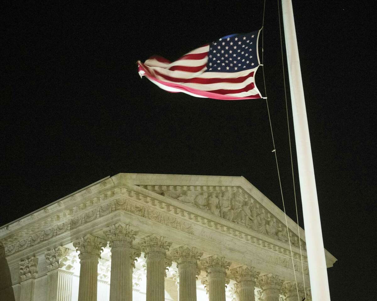 A U.S. flag flies at half-staff in front of the U.S. Supreme Court in Washington Feb. 13, 2016, after is was announced that Supreme Court Justice Antonin Scalia, 79, had died.