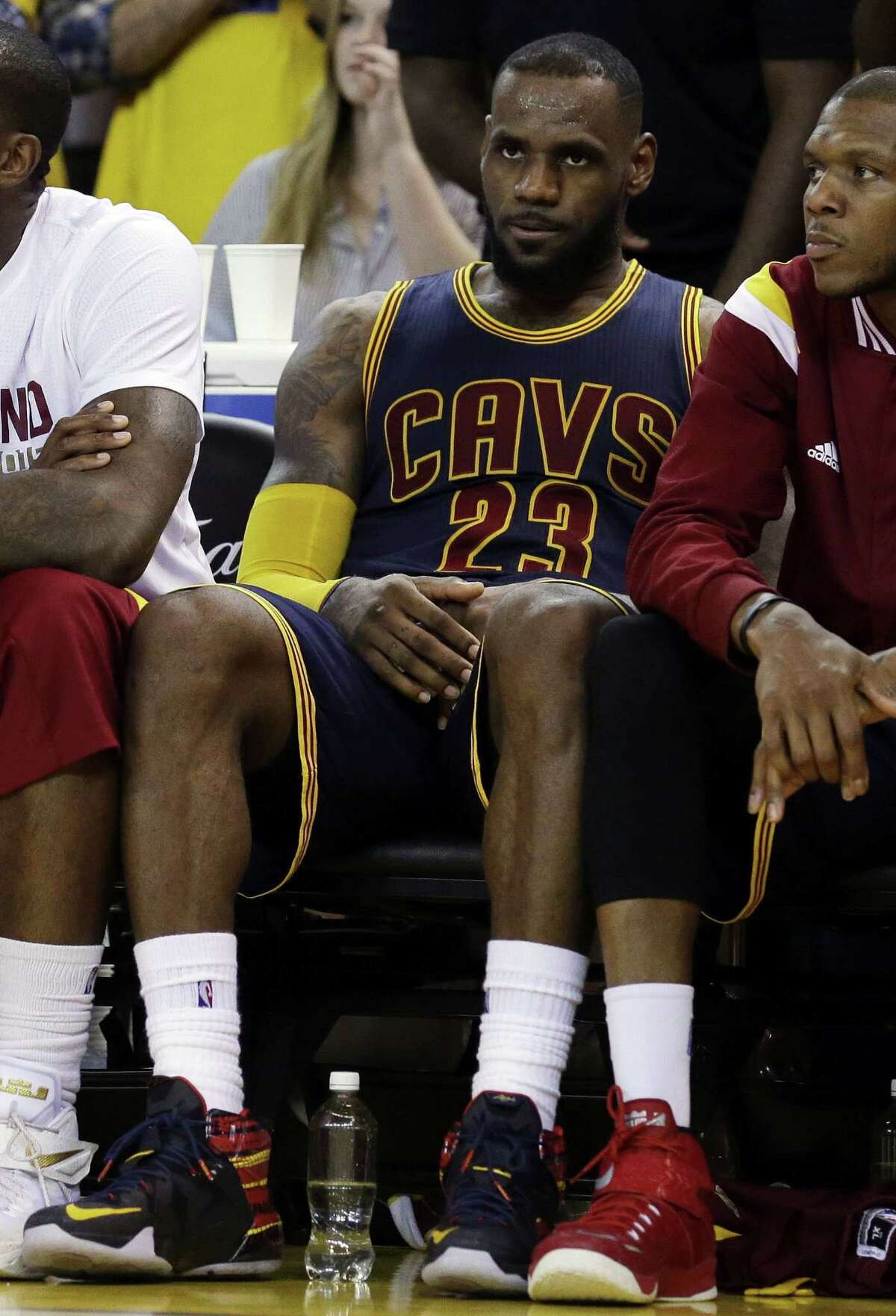 Cleveland Cavaliers forward LeBron James sits on the bench during the second half of Game 5 of the NBA Finals on Sunday in Oakland, Calif.