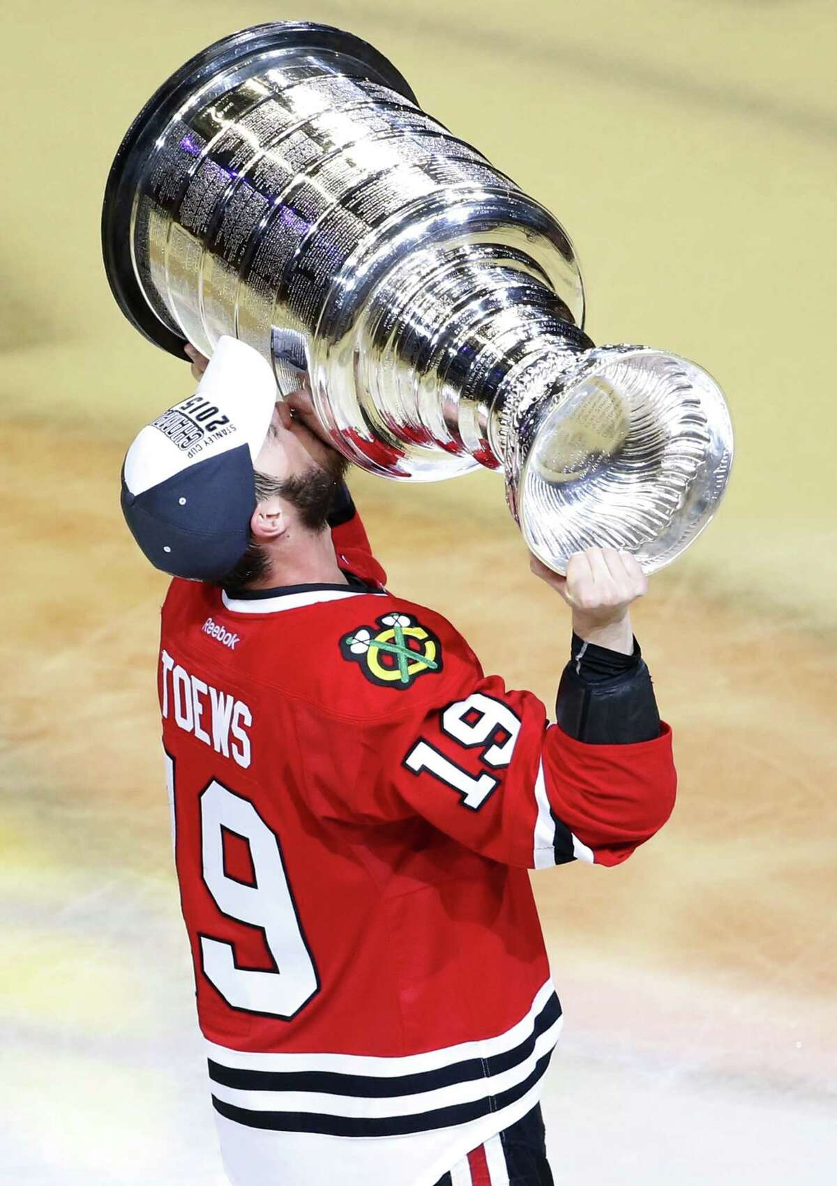 The Blackhawks' Jonathan Toews kisses the Stanley Cup trophy after defeating the Lightning in Game 6 of the Stanley Cup finals on Monday.