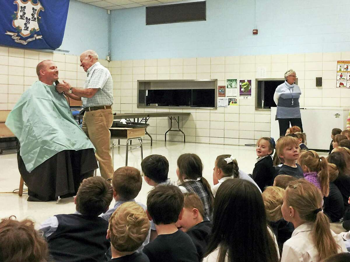 The Rev. Chris Gaffrey had his beard shaved in front of a boisterous group of St. Anthony school students Thursday afternoon to celebrate the students' fundraising efforts as part of the annual walk-athon event.