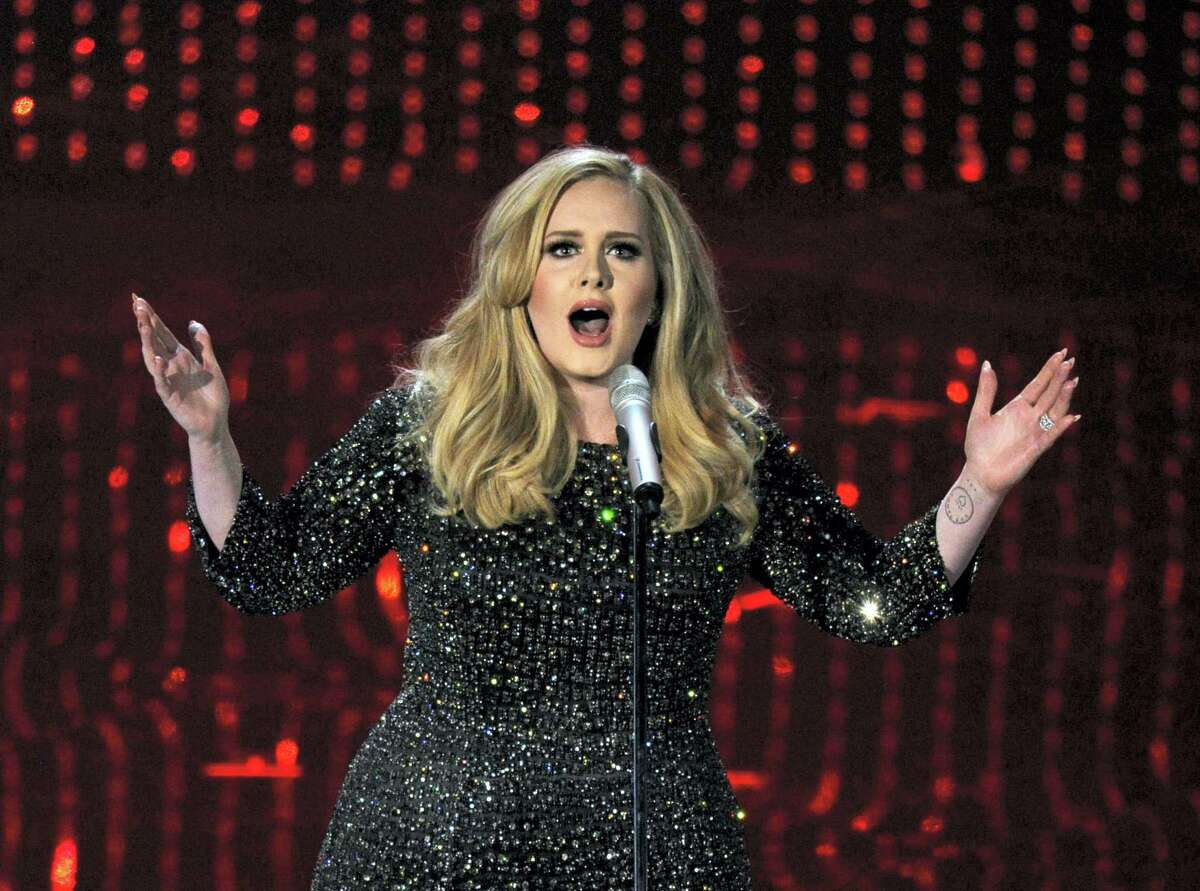 In this Feb. 24, 2013 photo, singer Adele performs during the Oscars at the Dolby Theatre in Los Angeles.