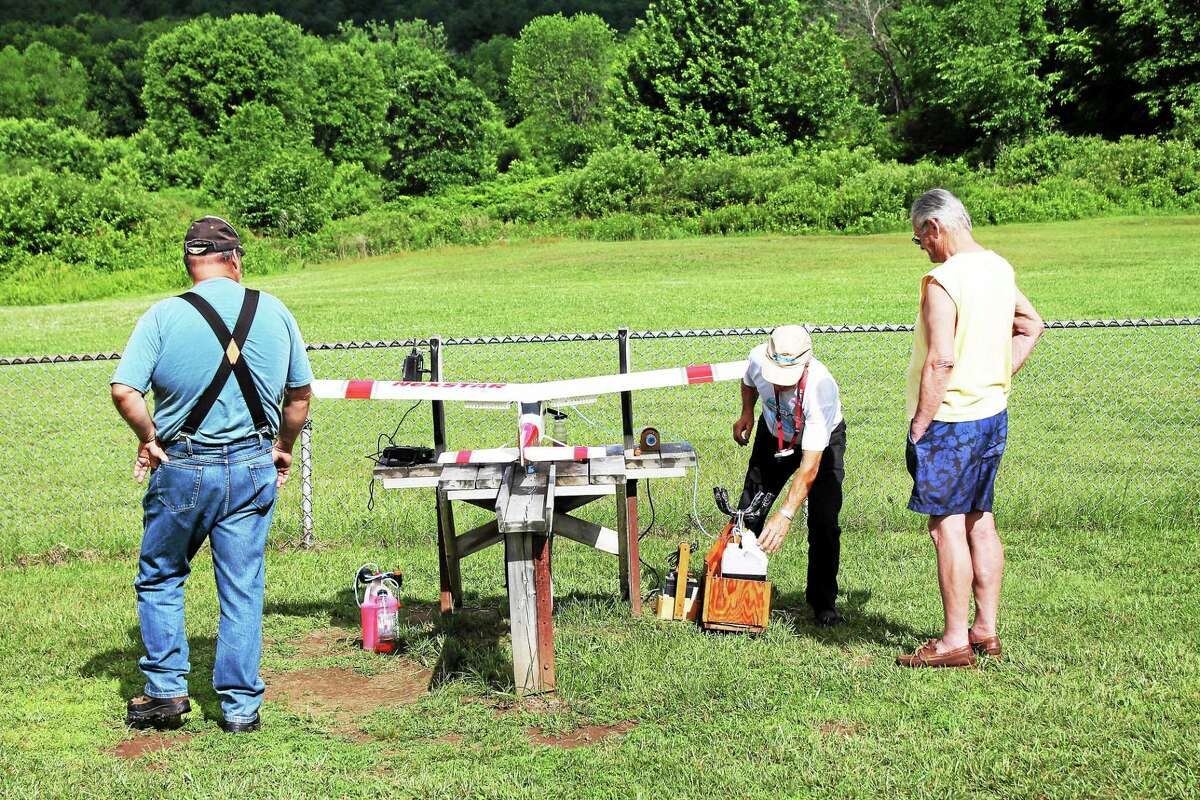 JOHN NESTOR -- REGISTER CITIZEN The Nutmeg RC Flyers held a ìBuddy Boxî event at the Leadmine Brook section of the Thomaston Dam Saturday to introduce people to radio-controlled flying.