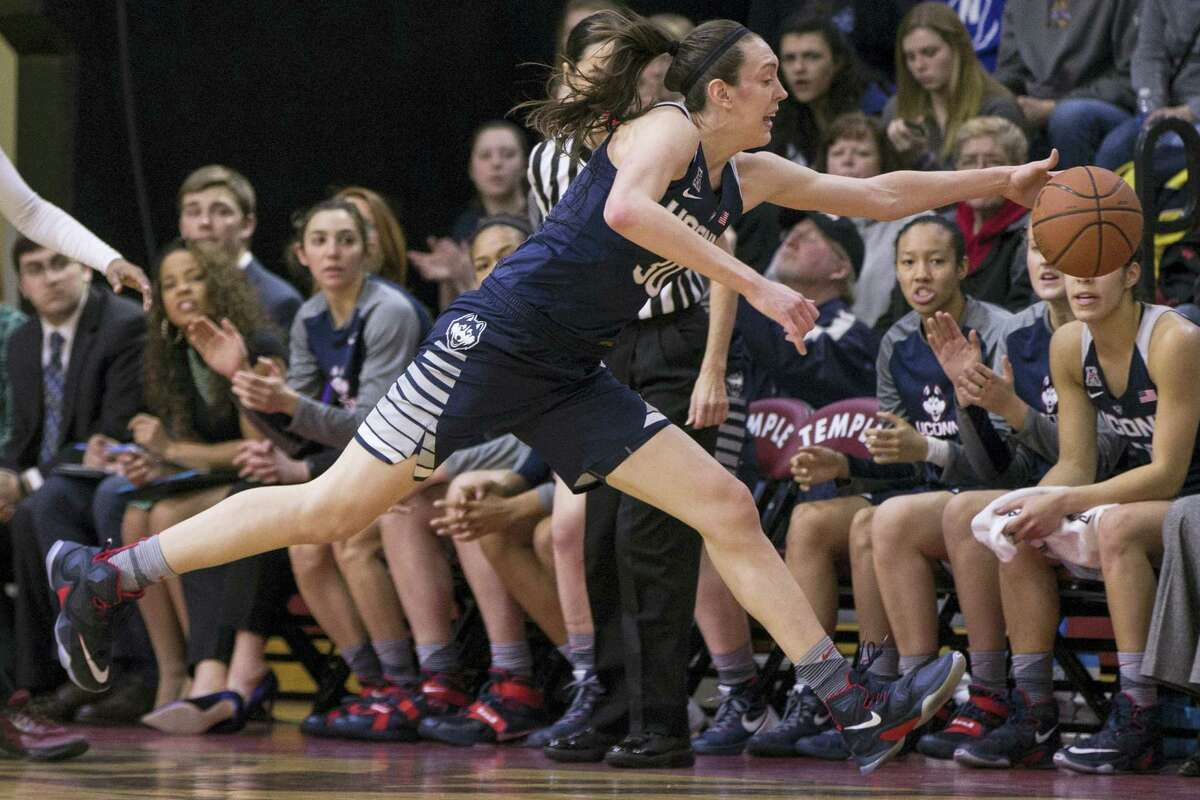 UConn's Breanna Stewart (30) goes reaching for a loose ball during the first half of Sunday's win over Temple.