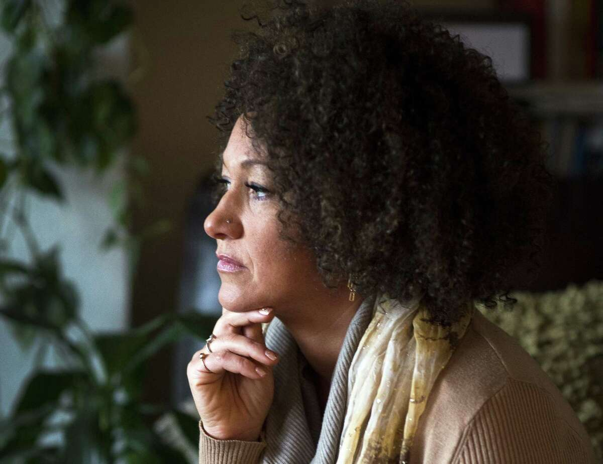 In this March 2, 2015 photo, Rachel Dolezal, president of the Spokane chapter of the NAACP, poses for a photo in her Spokane, Wash. home. Dolezal is facing questions about whether she lied about her racial identity, with her family saying she is white but has portrayed herself as black.