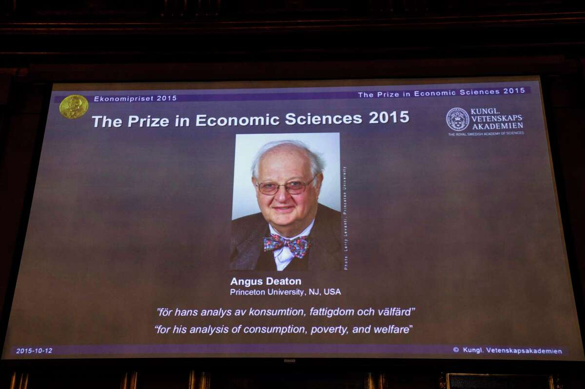 """A view of the screen showing an image of Professor Angus Deaton, winner of the 2015 Sveriges Riksbank Prize in Economic Sciences in Memory of Alfred Nobel. Permanent Secretary for the Royal Swedish Academy of Sciences addresses a press conference to announce the winner of the prize at the Royal Swedish Academy of Science in Stockholm, Sweden on Oct. 12, 2015. Scottish economist Angus Deaton has won the Nobel memorial prize in economic sciences for """"his analysis of consumption, poverty, and welfare,"""" the Royal Swedish Academy of Sciences said Monday."""