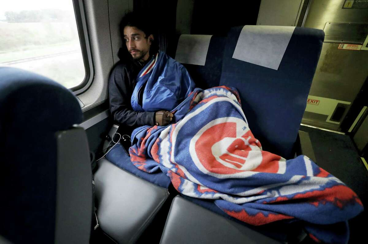 Salvador Cardenas, a 28-year-old dentist from Aurora, Illinois, watches out the train window.