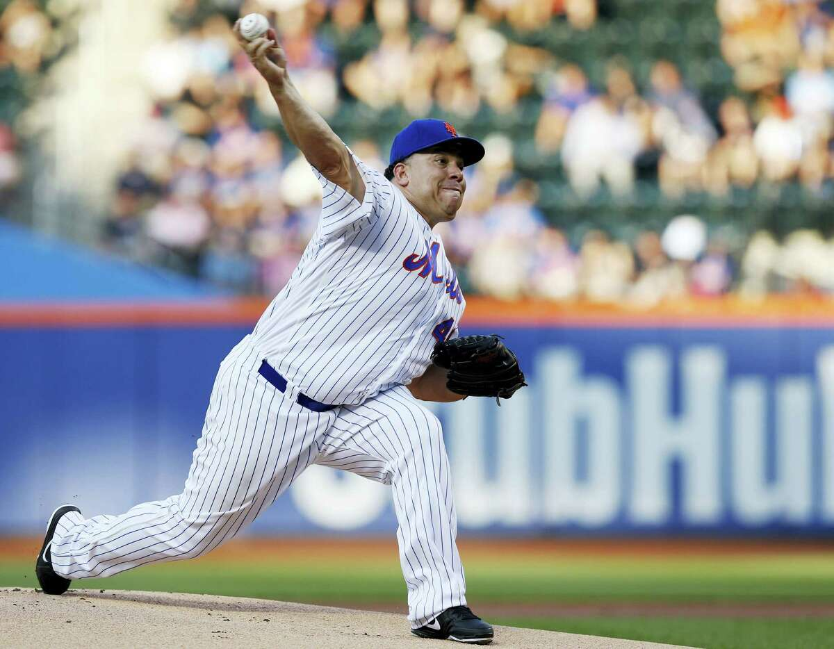 New York Mets starting pitcher Bartolo Colon (40) delivers during the first inning of a baseball game against the Kansas City Royals, Tuesday, June 21, 2016, in New York. Colon left the game after he was hit in the hand by Whit Merrifield's ground ball. (AP Photo/Kathy Willens)