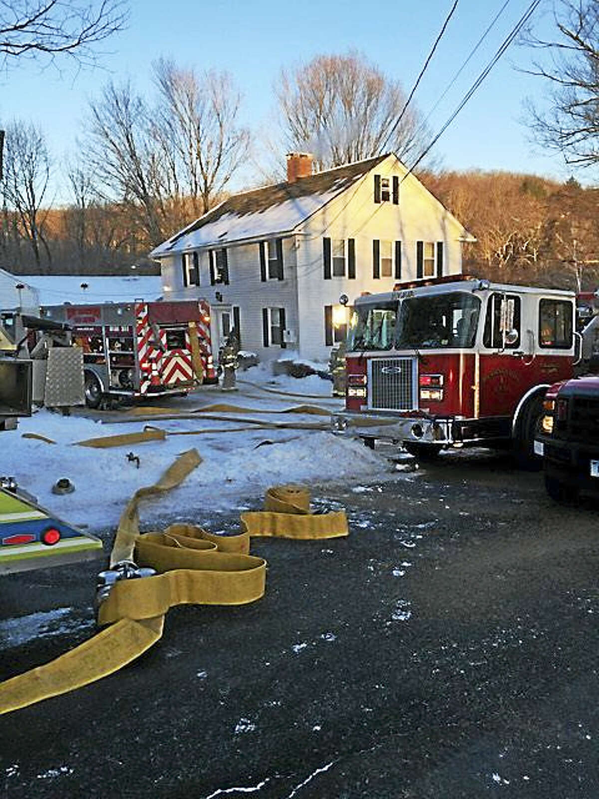 CONTRIBUTED PHOTO — PLEASANT VALLEY FIRE DEPT. A house fire Sunday at 87 West Hill Road is believed to have started when a resident tried to thaw frozen pipes with a heat gun, fire officials said.