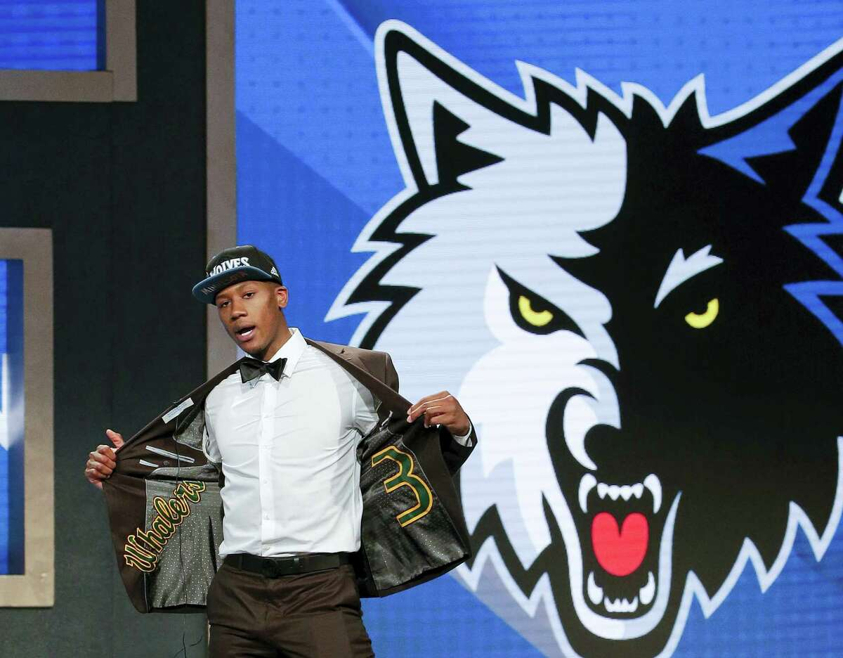Kris Dunn reacts as he steps up on stage after being selected fifth overall by the Minnesota Timberwolves during the NBA draft Thursday in New York.