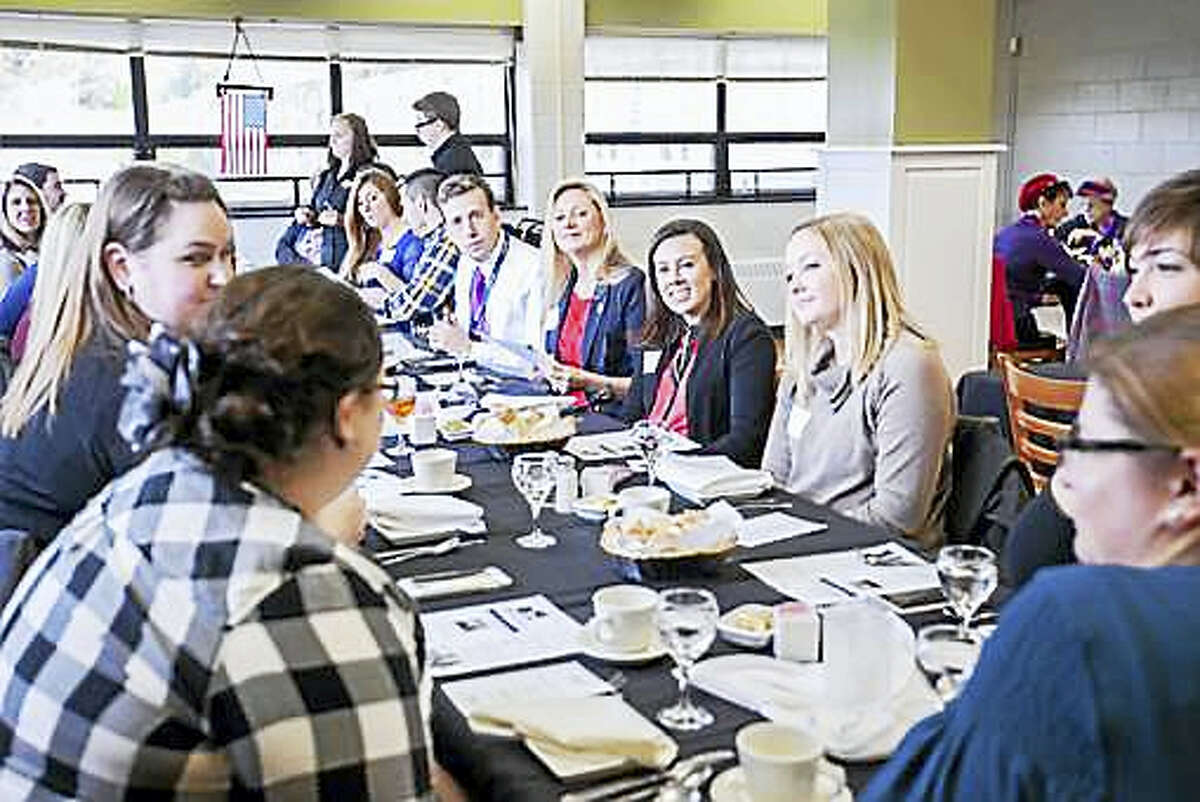 Reps. Matthew Lesser and Michelle Cook, center, listen to members of the Young Professionals of Northwest Connecticut during a recent discussion about the state's new student loan refinancing program.