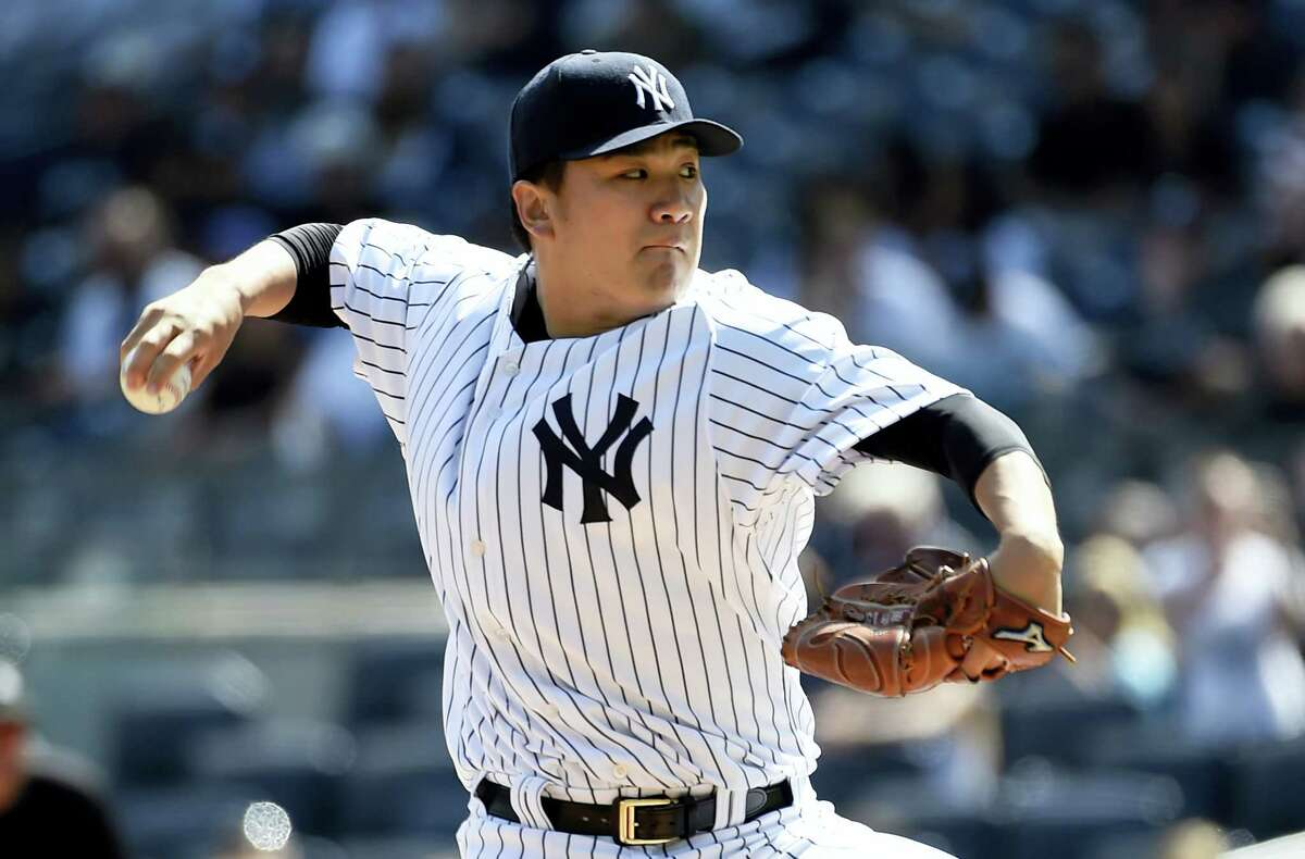 FILE - In this Sept. 13, 2015, file photo, New York Yankees starter Masahiro Tanaka pitches in the first inning of a baseball game against the Toronto Blue Jays in New York. Tanaka, coming back after arthroscopic surgery to remove a bone spur from his right elbow last October, says he feels perfectly healthy but is not sure when he will make his first regular-season start. (AP Photo/Kathy Kmonicek, File)