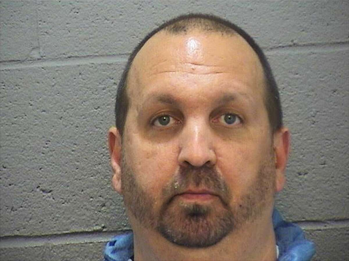 This image provided by the Durham County Sheriff's Office shows a booking photo of Craig Stephen Hicks, 46, who was arrested on three counts of murder early Wednesday, Feb. 11, 2015. He is being held at the Durham County Jail. Police were responding to a report of gunshots around 5:15 p.m. Tuesday when they found three people who were pronounced dead at the scene. The dead were identified as Deah Shaddy Barakat, 23, of Chapel Hill; Yusor Mohammad, 21, of Chapel Hill; and Razan Mohammad Abu-Salha, 19, of Raleigh. (AP Photo/Durham County Sheriff's Office)