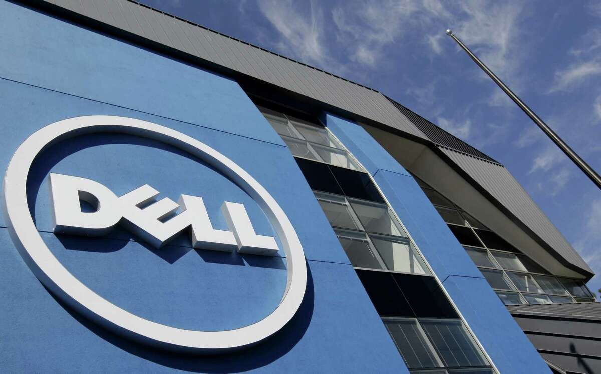 In this Aug. 21, 2012 photo, the sun is reflected in the exterior of Dell Inc.'s offices in Santa Clara, Calif.