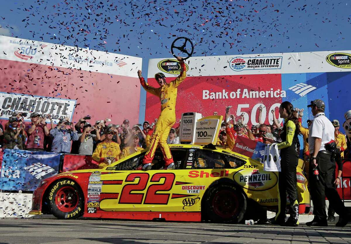 Joey Logano celebrates in Victory Lane after winning at Charlotte Motor Speedway on Sunday.