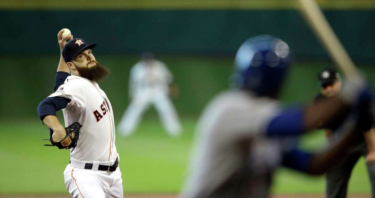 The Astros' Dallas Keuchel throws a pitch to the Royals' Lorenzo Cain during the first inning Sunday.