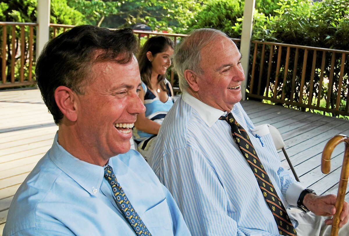 Former Connecticut Gov. Lowell Weicker, right, sits with former U.S. Senate candidate Ned Lamont during a fundraiser in this 2006 file photo.
