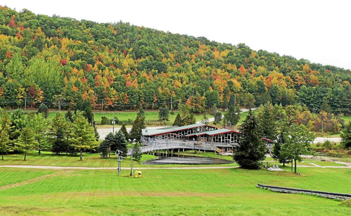 The lodge addition at Mohawk Mountain, seen at right, is being built to seamlessly blend in with the original structure.