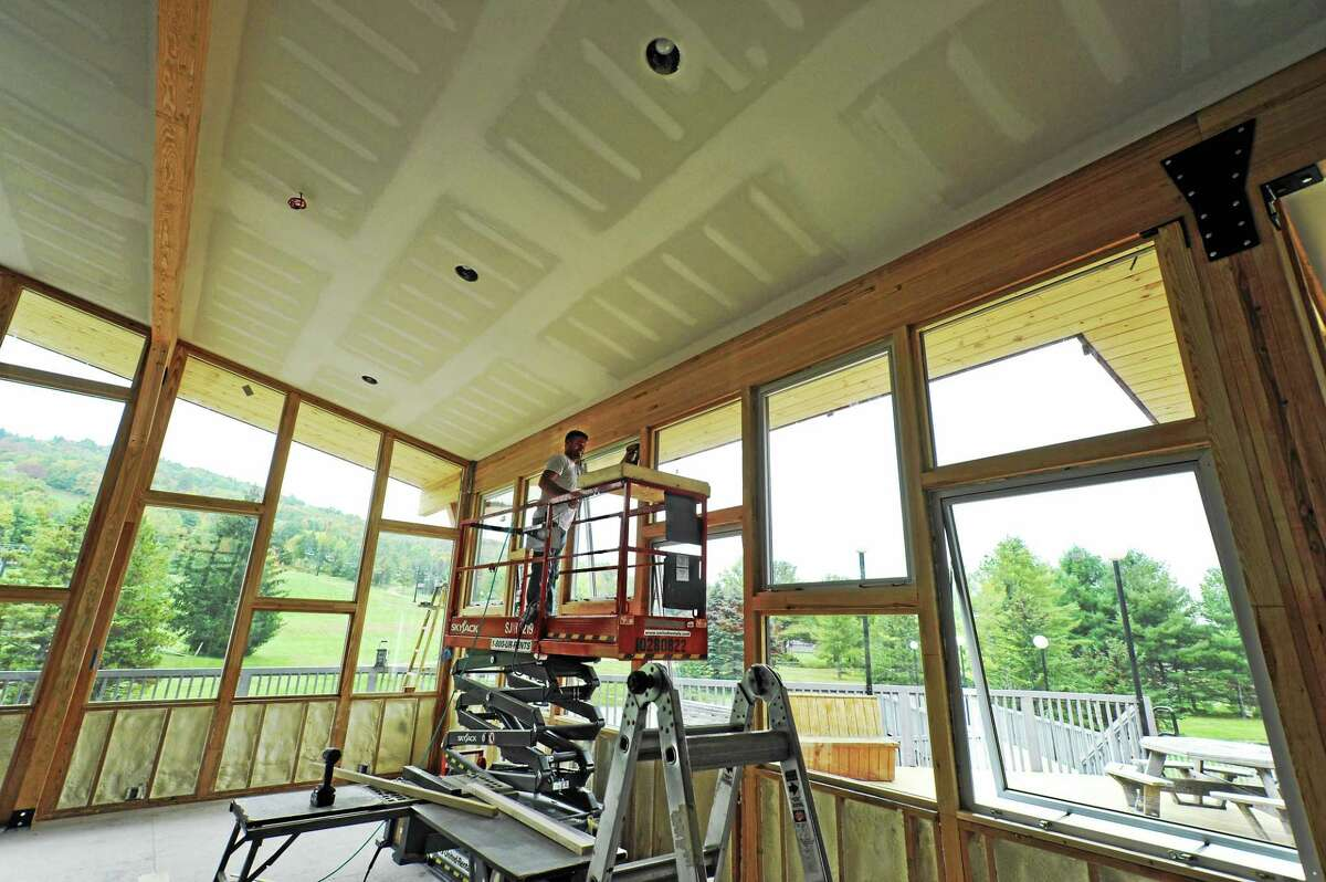 Jason Fletcher of Warren based DeLayo Construction does some trim work in the new lodge addition at Mohawk Mountain.