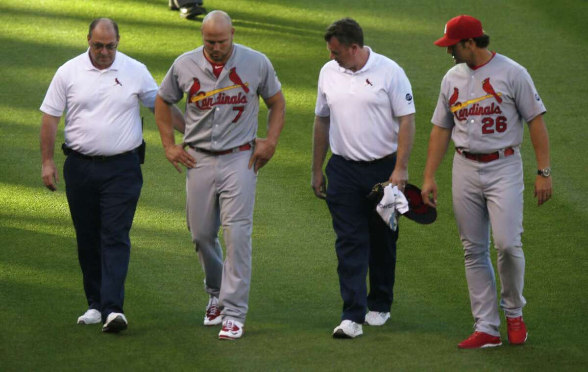 Matt Holliday, second from left, is the latest Cardinals to get hurt, but St. Louis keeps on finding ways to win.