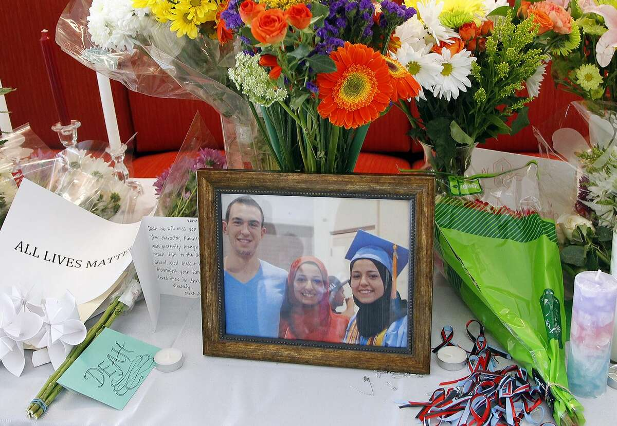 A makeshift memorial appears on display, Wednesday, Feb. 11, 2015, at the University of North Carolina School of Dentistry in Chapel Hill, N.C., in remembrance of Deah Shaddy Barakat, 23, Yusor Mohammad, 21, and Razan Mohammad Abu-Salha, 19, who were killed on Tuesday. Craig Stephen Hicks, 46, has been charged with three counts of first-degree murder in the case.