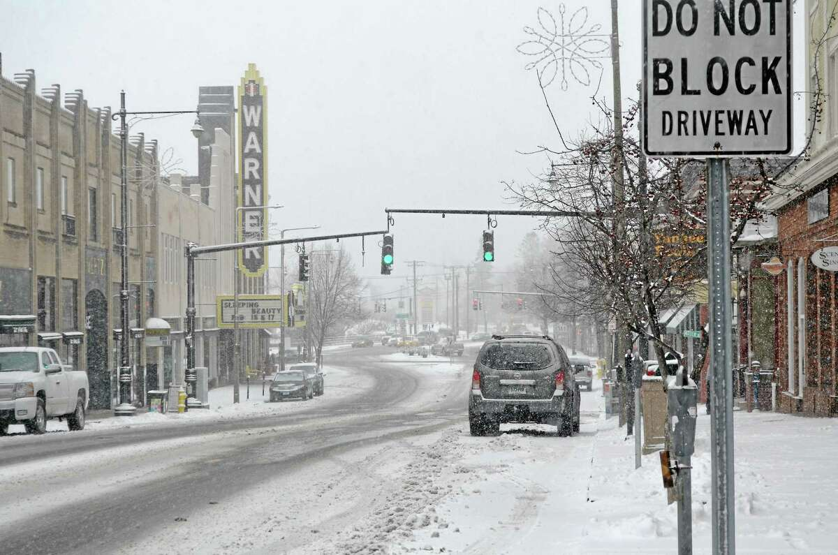 Snow falls steady in Torrington in this February 2013 file photo.