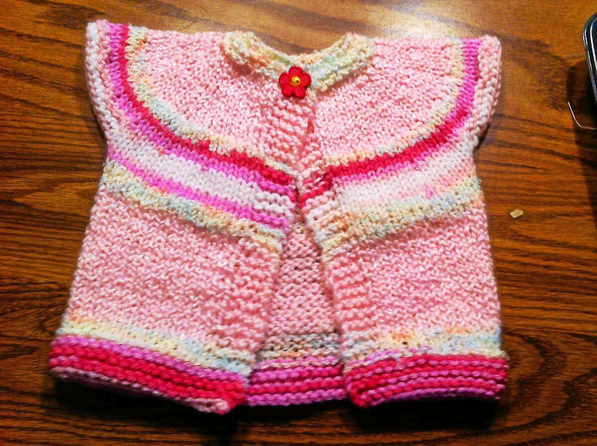 Photo by Ginger Balch This little top down, no sew sweater is one of my favorite go to designs for beginners and experts alike. Sometimes itís nice to just be able to knit with out really thinking, and end up with a really cute project.