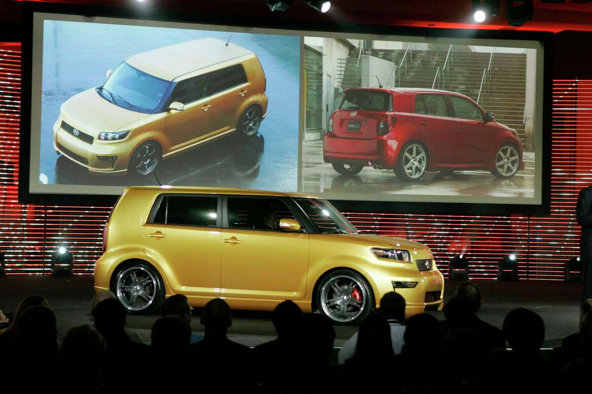 In this Feb. 8, 2007, photo, the 2008 Scion xB, foreground, is unveiled along with the xD, background right, during the Chicago Auto Show in Chicago.