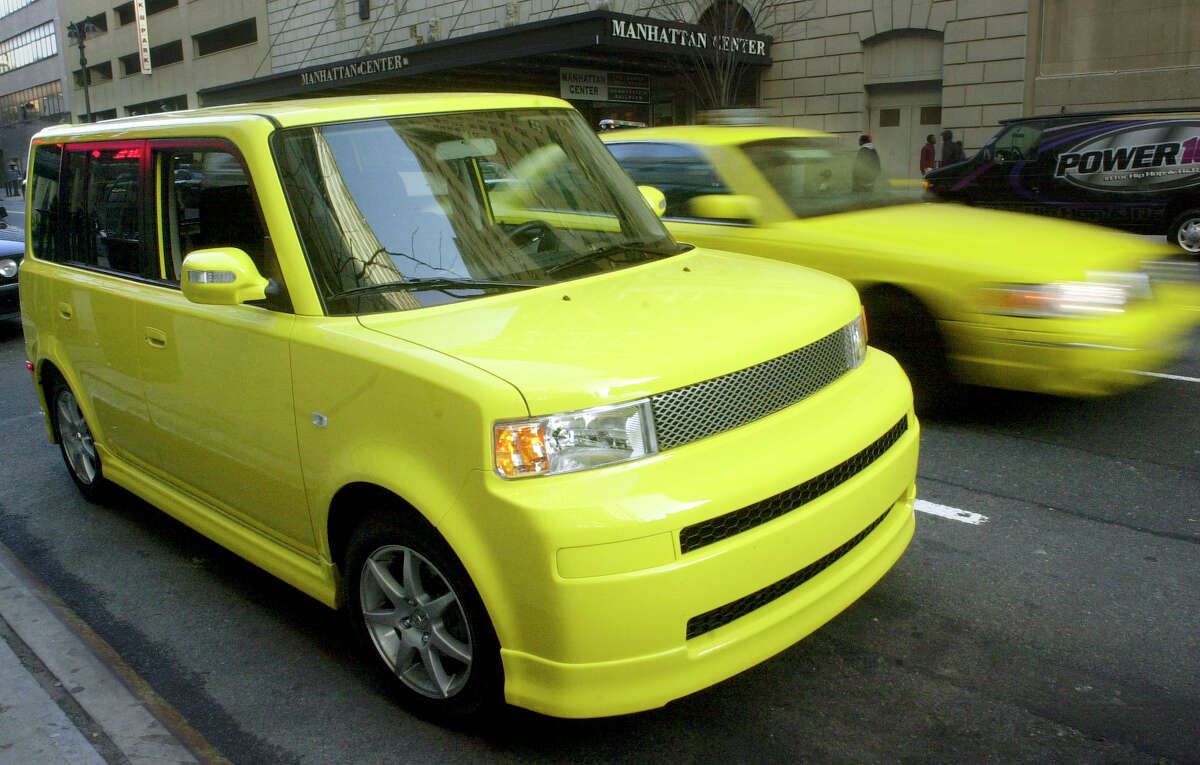 In this April 16, 2005, photo, a solar yellow Scion limited-production xB Release Series 2.0 is parked in Manhattan as part of a corporate promotion in New York.