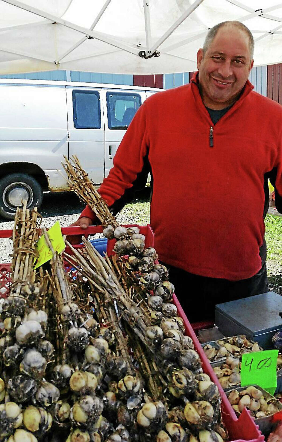 N.A. Ambery photo Anthony Caltabiano of Caltabiano Farms in Phoenix, New York, sells German white garlic bulbs at the 11th Annual Connecticut Garlic & Harvest Festival.