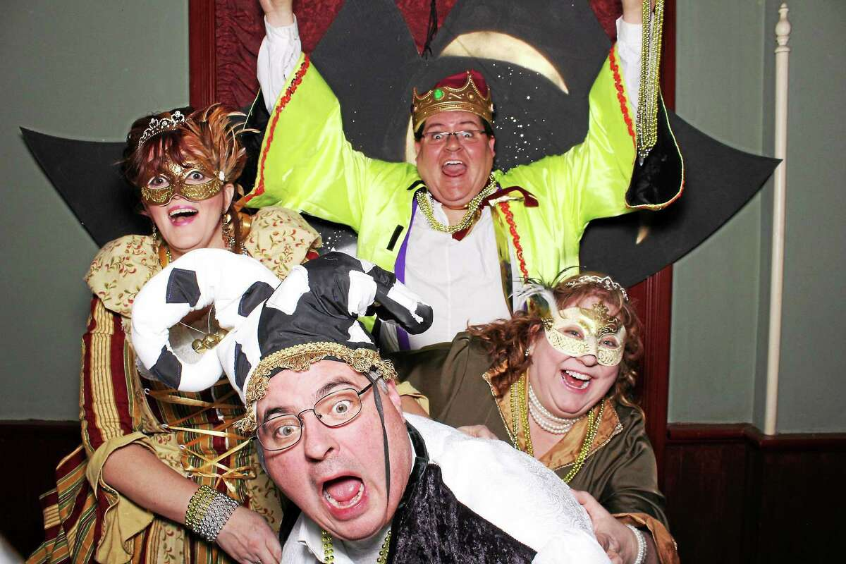 Contributed photo Members of Landmark Community Theatre are throwing a party Saturday night, and we're all invited; above, Jeffrey Dunn, Executive Director, dressed as the Mardi Gras Court Jester, center, is joined by other members of the theater group.