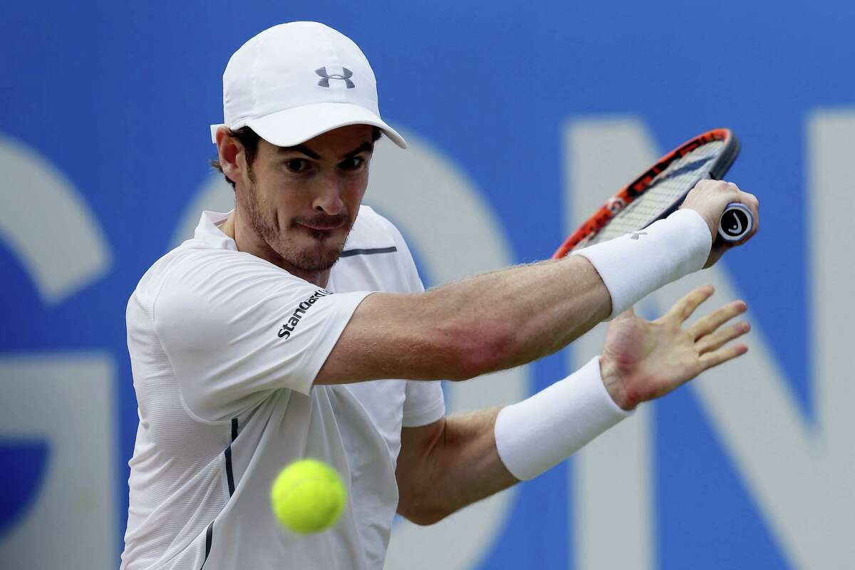 Britain's Andy Murray plays a return to Canada's Milos Raonic during their final tennis match at Queen's Championships London, England on June 19, 2016.