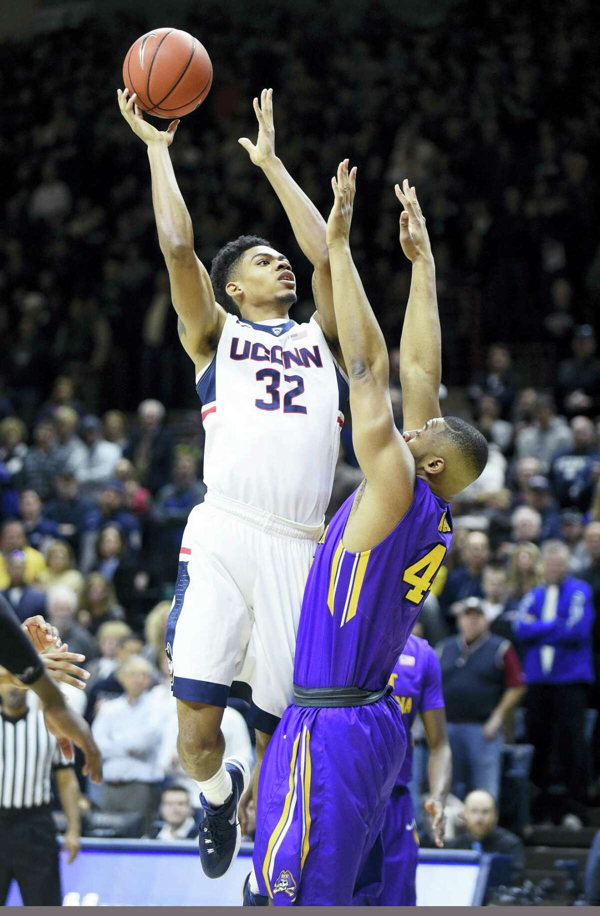 UConn's Shonn Miller (32) and his Husky teammates are in a three-way tie for third place in the American Athletic Conference.