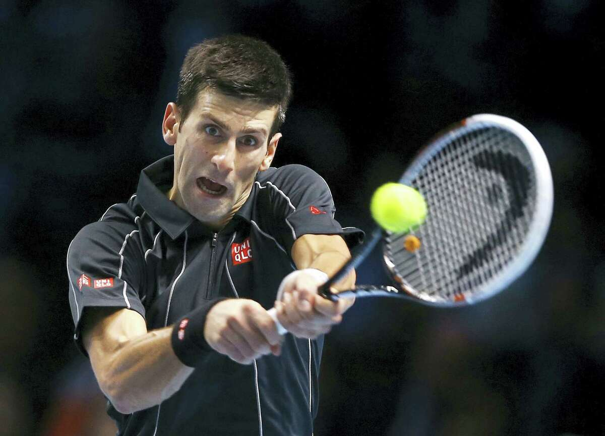 Novak Djokovic of Serbia plays a return to Roger Federer of Switzerland during their ATP World Tour Finals tennis match at the O2 Arena in London on Nov. 5, 2013.