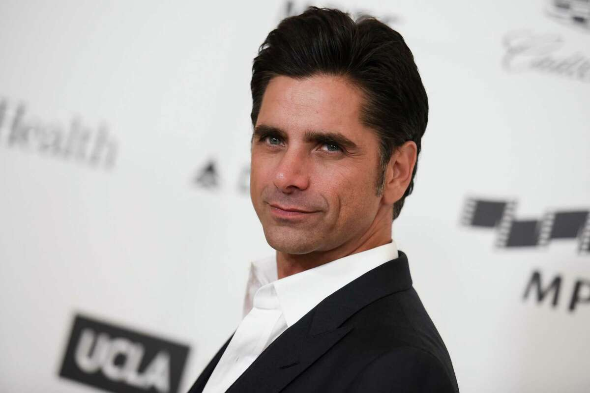 FILE - This April 25, 2015, file photo shows actor John Stamos arriving at the 4th Annual Reel Stories, Real Lives Benefit in Los Angeles. Stamos has been arrested and cited with driving under the influence in Beverly Hills. Beverly Hills police say they received calls around 7:45 p.m. Friday, June 12, 2015, reporting a possible drunk driver. Police later stopped Stamos, who was the only person in the vehicle. Police say Stamos was taken to a hospital because of a possible medical condition. (Photo by Richard Shotwell/Invision/AP, File)