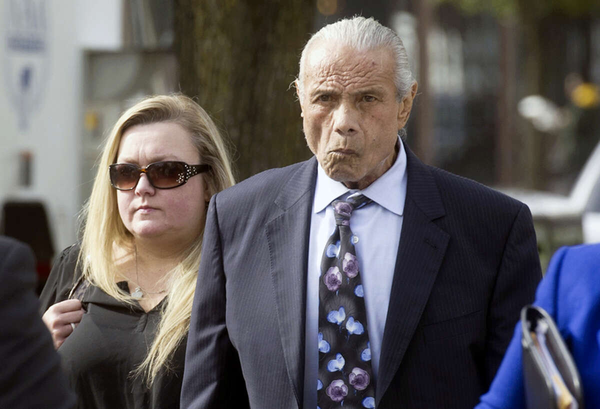 """In this Nov. 2, 2015 photo, former professional wrestler Jimmy """"Superfly"""" Snuka, right, arrives for his formal arraignment at the Lehigh County Courthouse in Allentown, Pa. Lehigh County Judge Kelly Banach ruled from the bench Wednesday, June 1, 2016, that Snuka is incompetent to stand trial on murder and manslaughter charges filed against him in 2015, more than 32 years after the death of his 23-year-old girlfriend Nancy Argentino on May 11, 1983."""