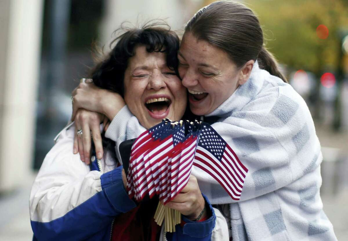 Kelli Stewart, right, celebrates with Maureen Valdez outside the Mark O. Hatfield United States Courthouse after the leaders of an armed group who seized a national wildlife refuge in rural Oregon were acquitted Thursday, Oct. 27, 2016 in the 41-day standoff that brought new attention to a long-running dispute over control of federal lands in the U.S. West.