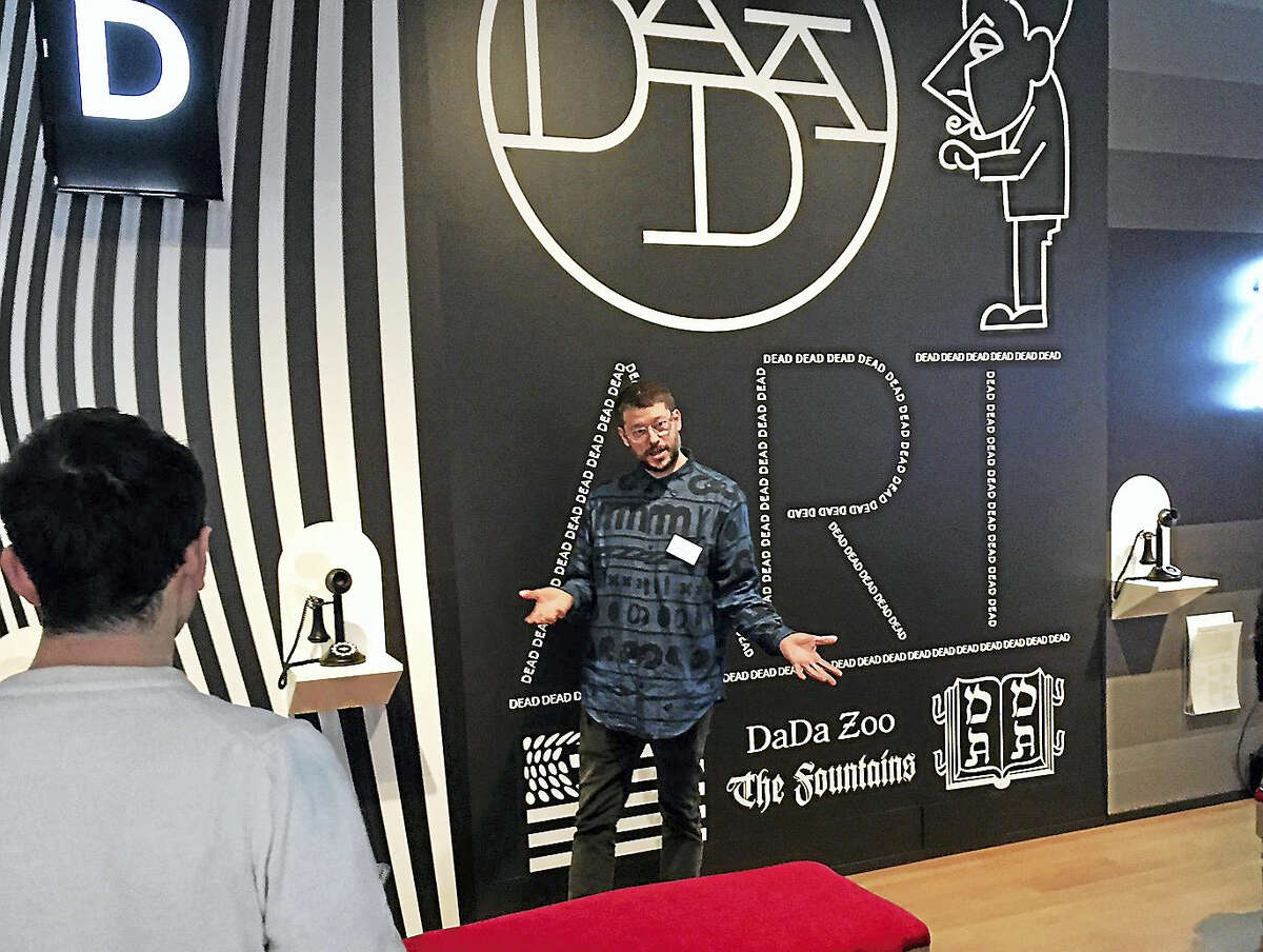 Chris Sleboda, who oversaw the graphics and look of the Dada Lounge, makes a point Wednesday.